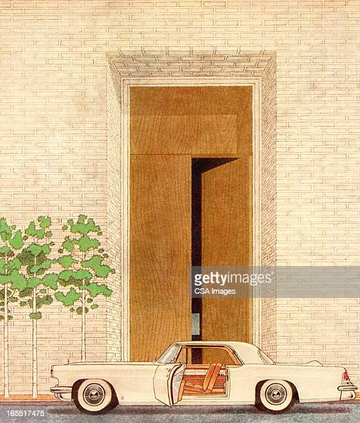 Car with an Open Door in front of an Open Door
