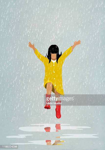 carefree girl jumping in rain puddles - carefree stock illustrations