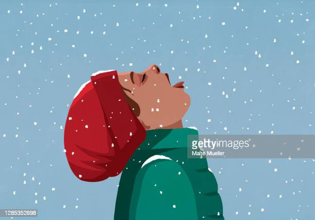 carefree girl with head back eating falling snow - headwear stock illustrations