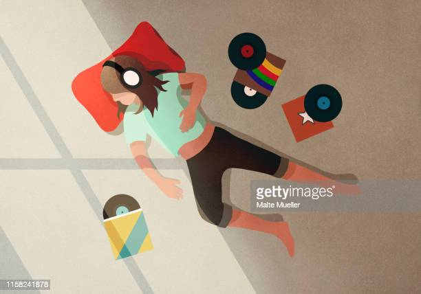 carefree girl with headphones listening to records - carefree stock illustrations
