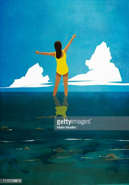 carefree woman with arms outstretched wading in summer ocean - image technique stock illustrations