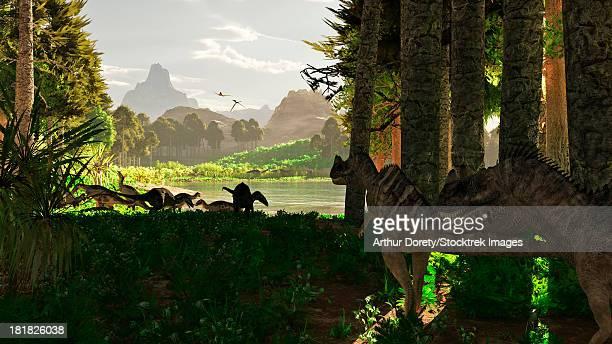 carnivorous ceratosaurus dinosaurs stalk a herd of camptosaurus eating plants. - prehistoric era stock illustrations