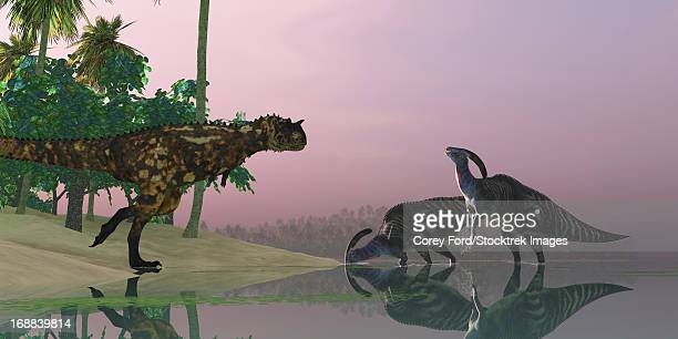A Carnotaurus dinosaur attacks two Parasaurolophus dinosaurs eating underwater vegetation in the Cretaceous era.