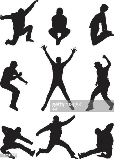 Casual men posing mid air jumping
