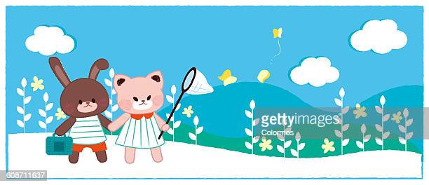 Cat and Rabbit going on picnic on sunny day