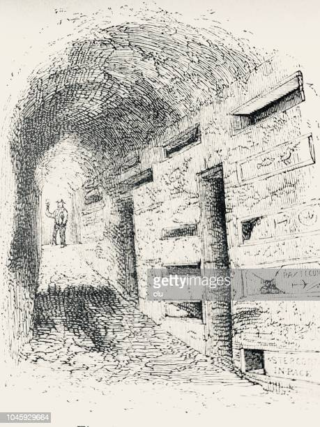 catacombs in rome: gallery with tombs - trastevere stock illustrations