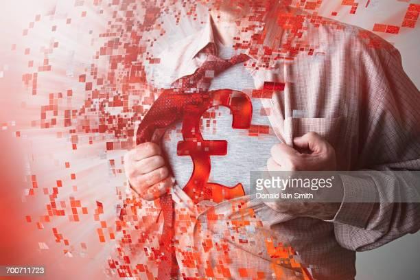 Caucasian businessman opening shirt revealing British pound symbol