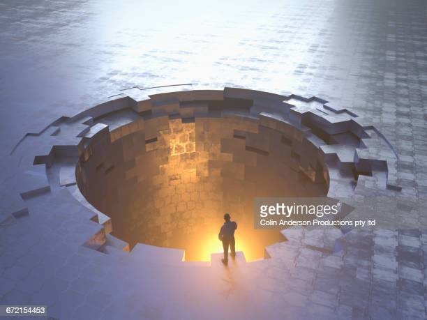 caucasian man examining glowing metal hole - reveal stock illustrations, clip art, cartoons, & icons