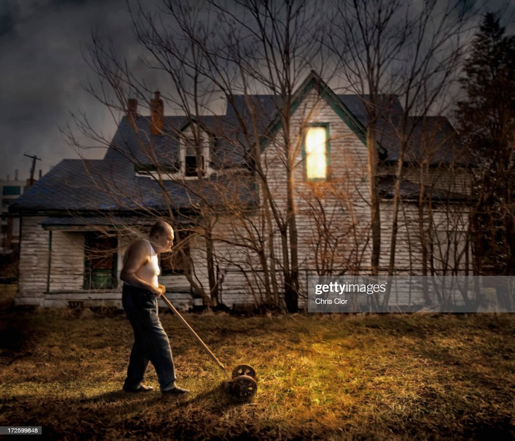 Caucasian man mowing lawn outside home : stock illustration