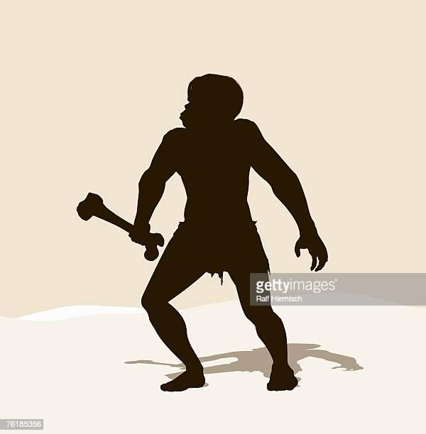 A caveman holding a bone