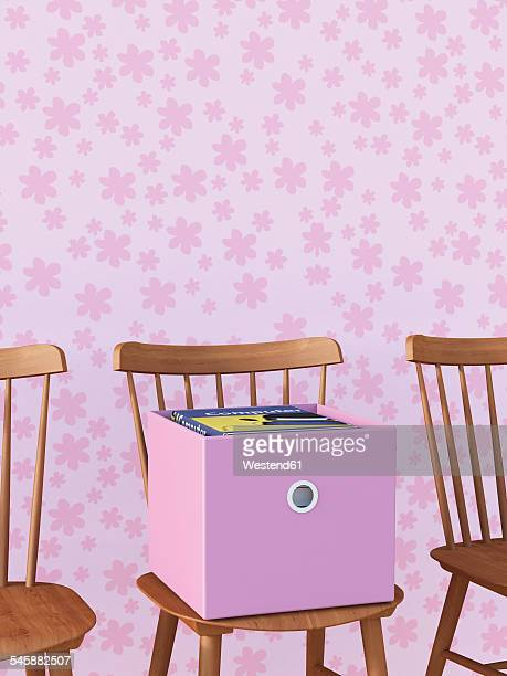 chair with cardboard box of books in front of pink wallpaper with floral design - new home stock illustrations, clip art, cartoons, & icons