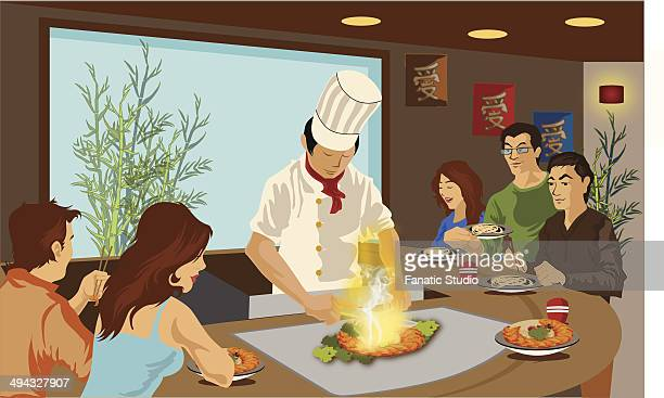 Chef cooking Japanese cuisine in a restaurant