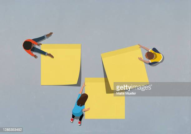 children with large yellow adhesive notes - ideas stock illustrations