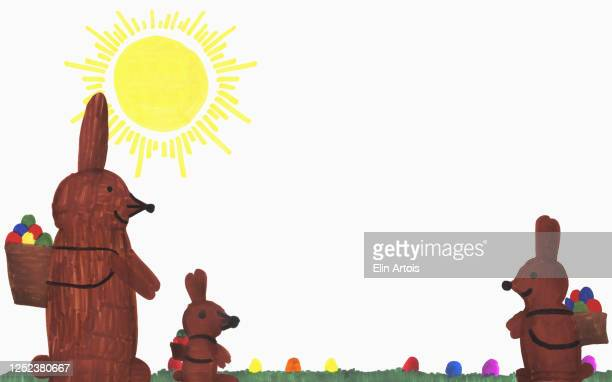 childs drawing easter bunnies with eggs in sunny grass - osterhase stock-grafiken, -clipart, -cartoons und -symbole
