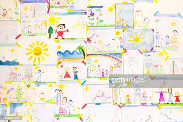 child's drawings hanging on wall - drawing activity stock illustrations