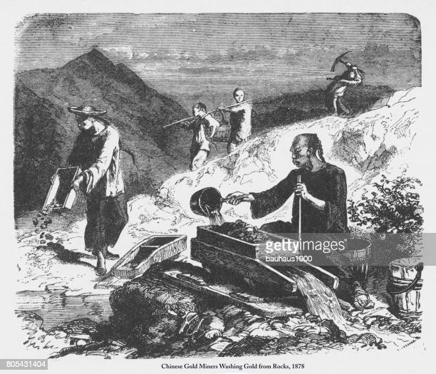 chinese gold miners washing gold from rocks engraving, 1878 - gold rush stock illustrations