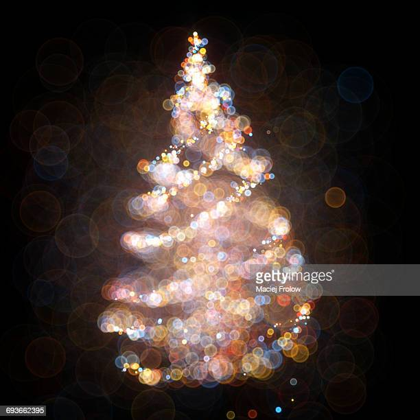 christmas tree made of bokeh dots - france stock illustrations