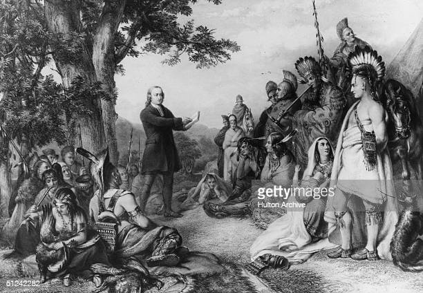 Circa 1736, English evangelist John Wesley , the founder of Methodism preaches to a group of Native Americans during his visit to Georgia.