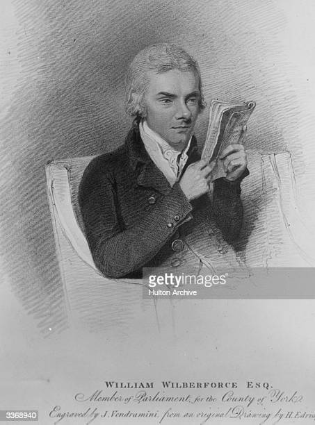 English philanthropist William Wilberforce , Member of Parliament for the County of York, reading a book. Original Artwork: Engraving by J Vendramini...