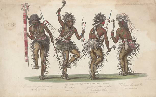 Four members of the Ojibwa tribe perform a war dance....
