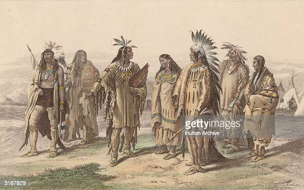 Representatives from various Native American tribes: from left to right, an Iroquois, an Assiniboine, a Crow, a Pawnee, an Assiniboine in gala dress,...