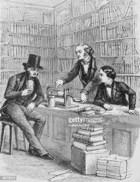 British scientist Michael Faraday demonstrating electrical apparatus to workmates at a booksellers