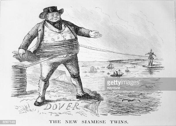 An Englishman on the cliff at Dover reaches across to his French counterpart in on the other side of the Channel in this Punch Magazine cartoon on...