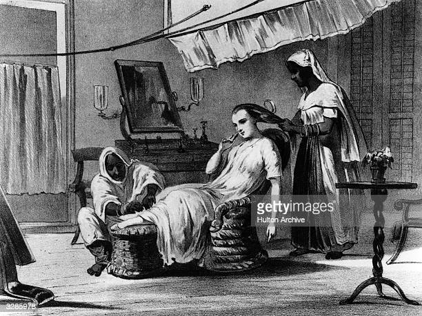 A magistrate's wife being groomed by her servants in India