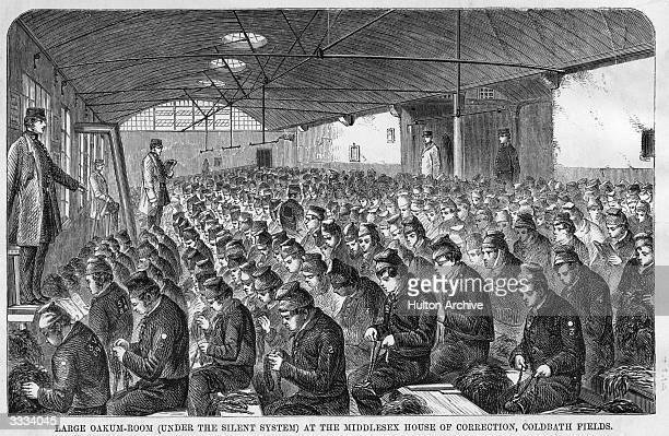 A roomful of convicts teasing out old tarred rope to be used for caulking ships The room is run under the silentstystem at the Middlesex House of...