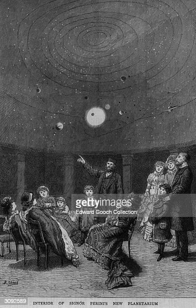 An astronomer giving a lecture at Signor Perini's planetarium