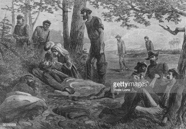 Predecessors of the Red Cross the Christian Commission and the Sanitary Commission attending the wounded on the battlefield during the American Civil...