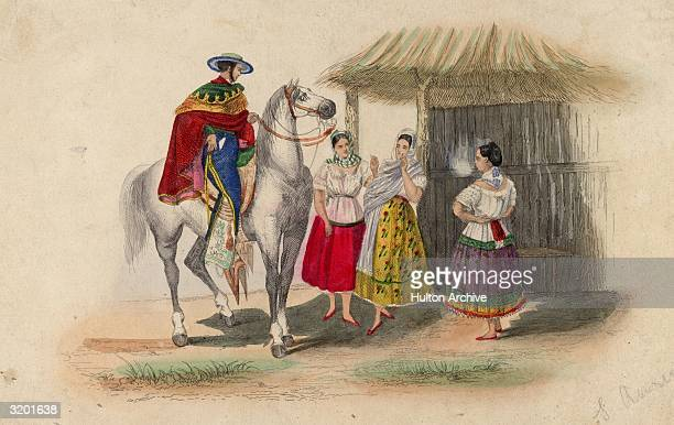A man on horseback talking to three women in Mexico All four are wearing brightly coloured traditional Mexican dress
