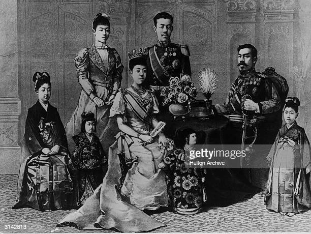 Meiji , emperor of Japan , born Prince Mutsuhito, surrounded by his family. His accession to the throne marked the beginning of a national revolution...