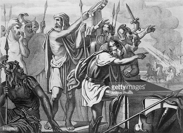 Circa 220 BC Illustration of Greek mathematician and inventor Archimedes surrounded by armored soldiers who direct mirrors at invading Roman warships...