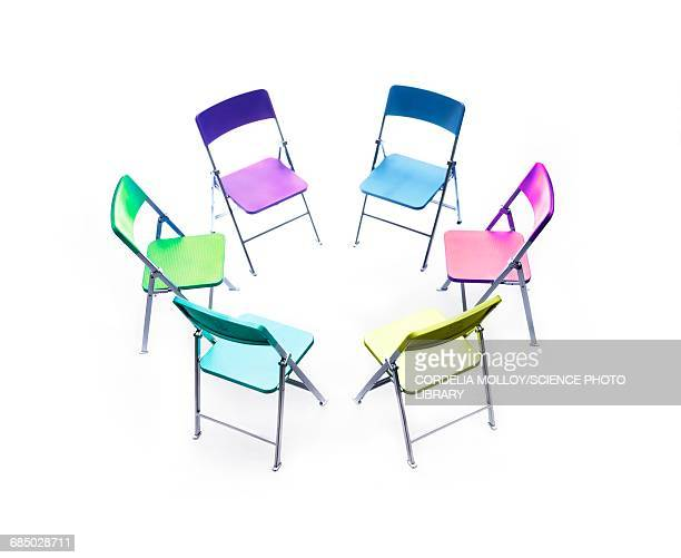 circle of chairs of different colours - meeting stock illustrations