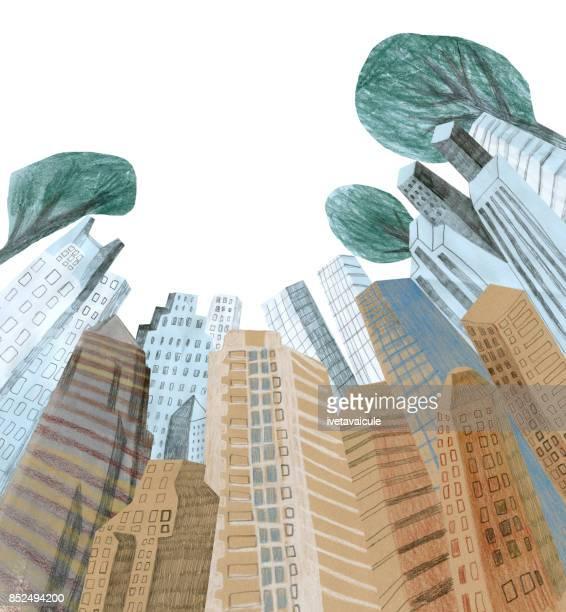 都市の建物や木々 を下から見る