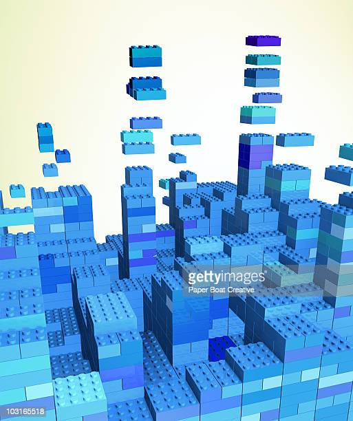 3d city made of simple blue building blocks - bloco stock illustrations