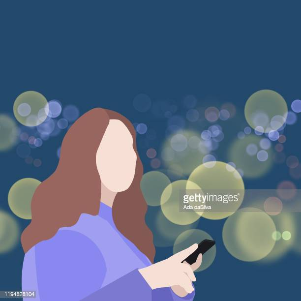 A city women using a phone in the night