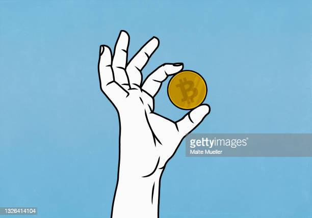 close up hand holding bitcoin on blue background - 仮想通貨点のイラスト素材/クリップアート素材/マンガ素材/アイコン素材