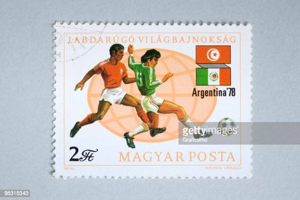 Close up of hungarian post stamp showing soccer players