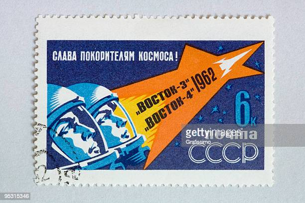close up of post stamp showing two astronauts in space - former soviet union stock illustrations