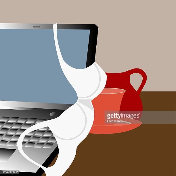 ilustraciones, imágenes clip art, dibujos animados e iconos de stock de close-up of a bra hanging on a laptop - sostén