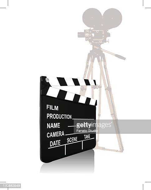 close-up of a movie camera with a film slate - erection stock illustrations, clip art, cartoons, & icons