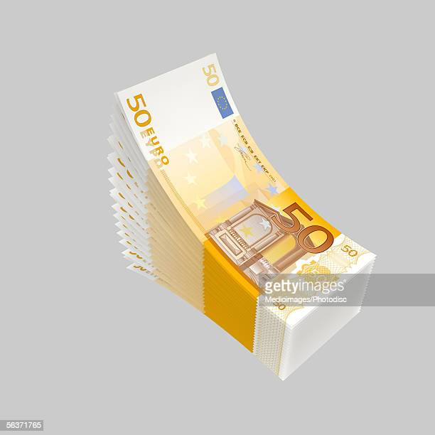 close-up of a stack of bank notes - european union euro note stock illustrations, clip art, cartoons, & icons