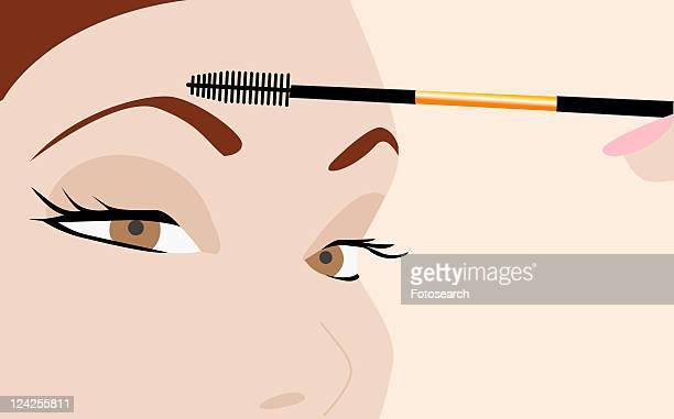 ilustrações, clipart, desenhos animados e ícones de close-up of a young woman applying mascara - sobrancelha