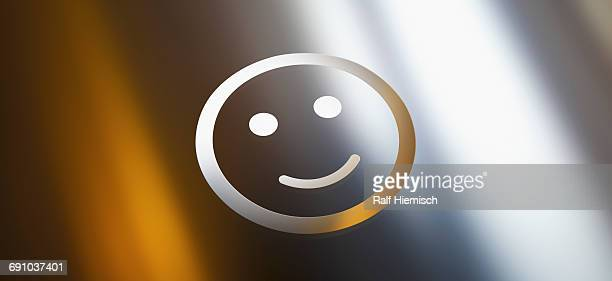 close-up of smiley face against gray gradient background - colour gradient stock illustrations