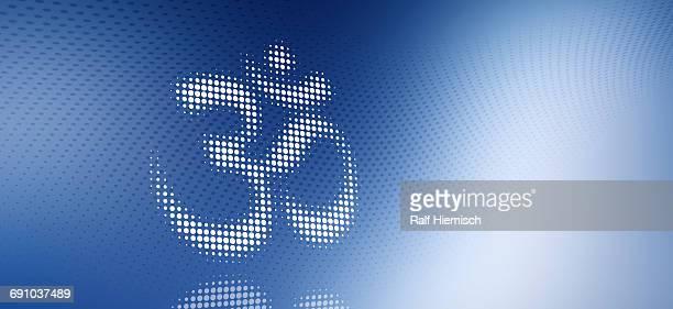 close-up of spotted om symbol over blue background - om symbol stock illustrations