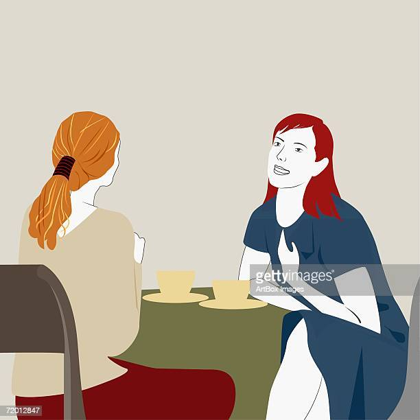 close-up of two young women sitting at the table in a restaurant - female friendship stock illustrations