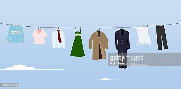 clothes hanging on a washing line - sweater stock illustrations, clip art, cartoons, & icons