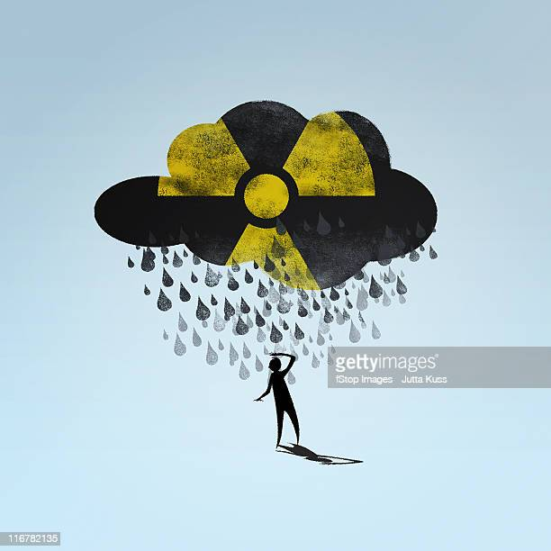 A cloud with a radioactive symbol raining on a person